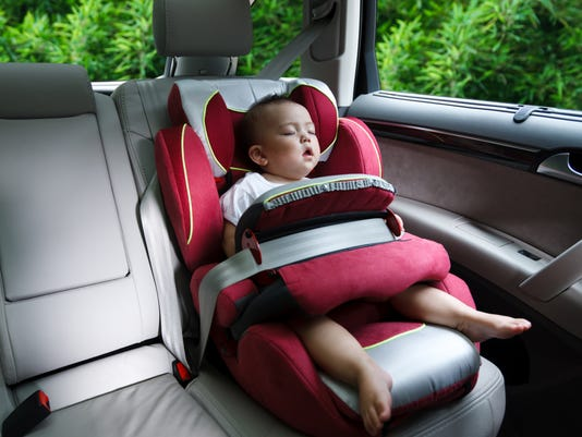 baby asleep in car seat