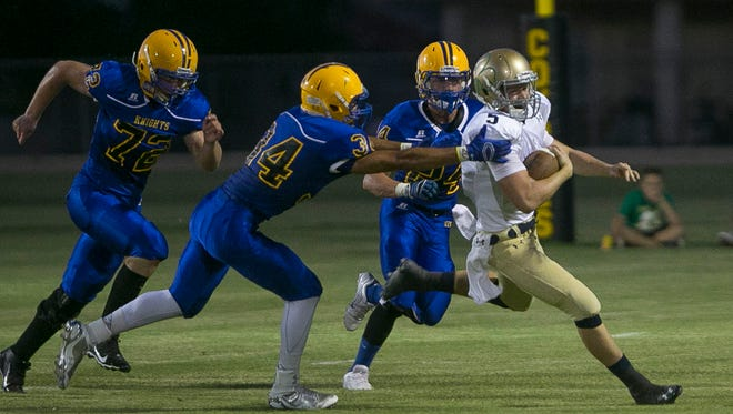 Yuma Catholic's Jagan Cleary gave Tempe Prep's defense fits during the season opener.