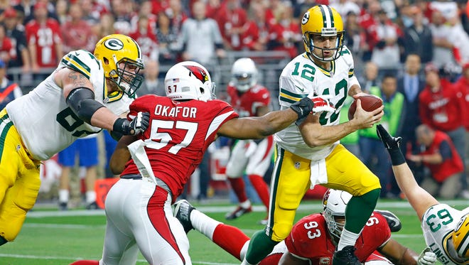 Arizona Cardinals outside linebacker Alex Okafor (57) pressures Green Bay Packers quarterback Aaron Rodgers (12)  in the first quarter of  their NFL game Sunday, Dec. 27, 2015 in Glendale, AZ.