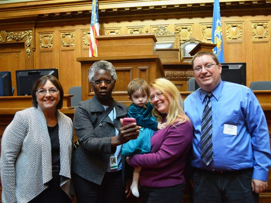 Dave, right, and Yvonne Truckey of Ledgeview were honored with a Governor's Outstanding Adoptive Parent award by Tonette Walker, left, and Wisconsin Department of Children and Families Secretary Eloise Anderson, second from left, at the State Capitol in Madison. The Truckeys accepted the award with their 2-year-old daughter Marysue.