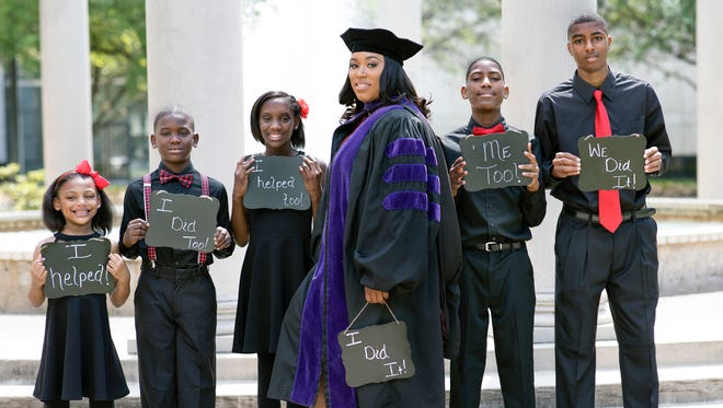 Ieshia Champs of Houston, Texas, stands alongside her children in her graduation photos.