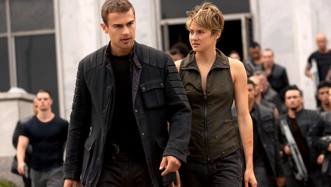 """In this image released by Lionsgate, Theo James, left, and Shailene Woodley appear in a scene from """"The Divergent Series: Insurgent."""" (AP Photo/Lionsgate, Andrew Cooper)"""