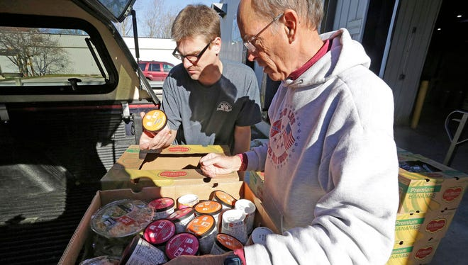 Steve Rankin, right, of St. Luke United Methodist Food Pantry, delivers produce that was outdated but still good from the Plymouth Walmart to the Sheboygan County Foodbank Wednesday November 9, 2016 in Sheboygan. At left is volunteer Brandon Roethel.