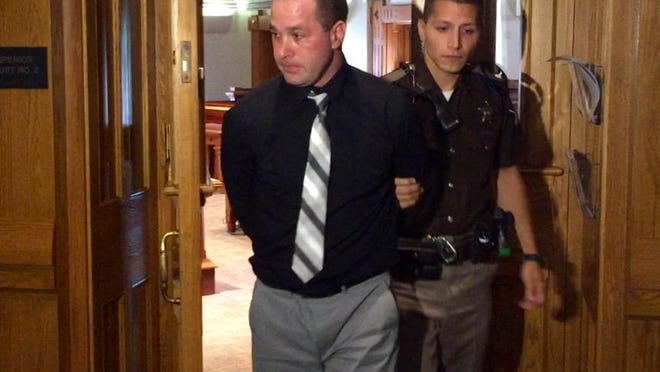 Jake Robinson, 38, exits Tippecanoe Superior Court 2 after his sentencing hearing on five counts of child seduction Friday, Aug. 7. As a coach and teacher at McCutcheon High School, Robinson engaged in a three-month sexual relationship with a 16-year-old student.