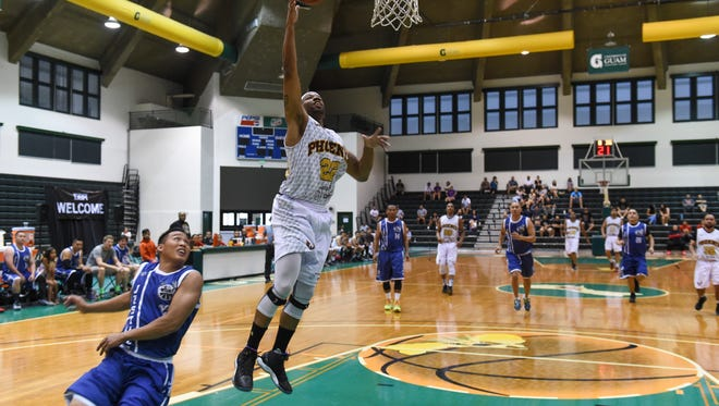 Auto Spot Phoenix Sons player Brian Cooper (22) makes the fastbreak layup against Team Justice during their Guam Basketball Association playoff game at the University of Guam Calvo Field House in Mangilao on May 1.