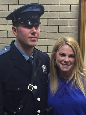 Vineland Police Officer Greg Pacitto, (shown here with his wife, Gena), was promoted to sergeant during a City Hall ceremony Thursday.