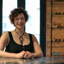 Tamra Asmuth, dispensing optician and owner of One Hip Chic on Park Avenue in Rochester on Tuesday, June 30, 2015.