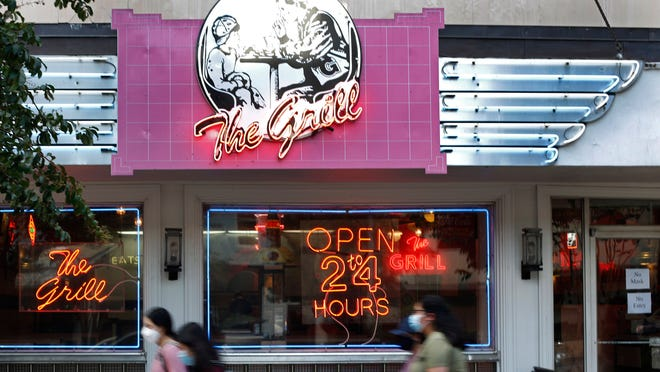 The Grill in downtown Athens, Ga, temporarily shut down in late March, when Georgia Governor Brian Kemp limited restaurant capacity to 10 or less statewide. The restaurant finally reopened with mandatory mask signs in the window on Thursday, Sept. 10, 2020, after being shut down for six months.