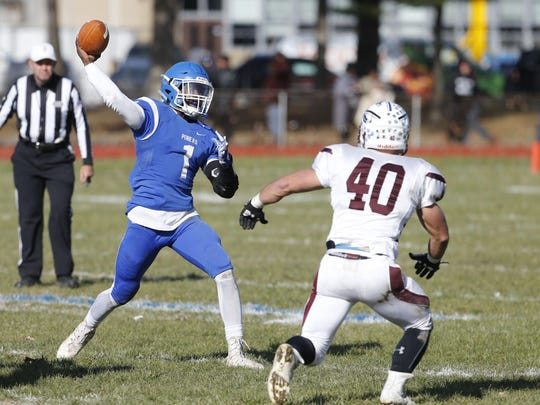 Quarterback Zyheir Jones (1) of Lakewood, passes against Teddy Suarez (40) of Toms River South, during football game at Lakewood High School on Thanksgiving Day.