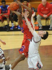 Cooper's Elijah Brown, left, drives to the basket while