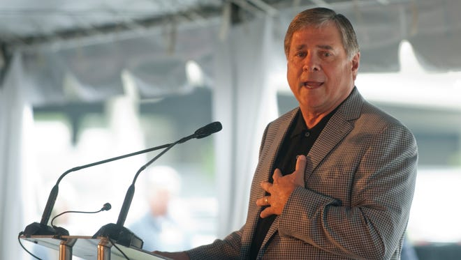 Tom Jurich speaks at the grand opening of the UofL Thorntons Academic Center of Excellence at the south end of Papa Johns Cardinal Stadium.