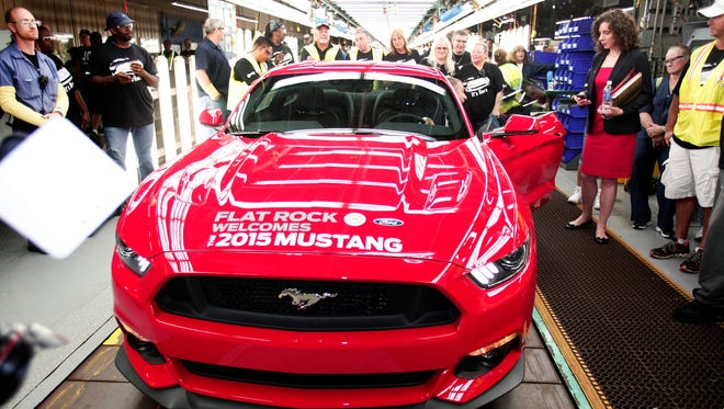 The first production 2015 Ford Mustang sits waiting to be driven off the assembly line at the Ford Flat Rock Assembly Plant on Aug. 28 in Flat Rock, Mich.