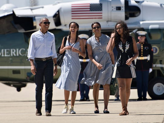 The Obama family walks to Air Force One at Castle Airport