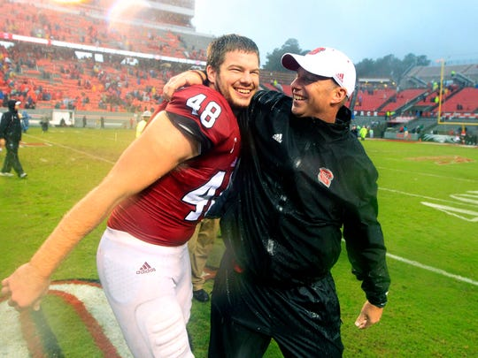 N.C. State coach Dave Doeren celebrates with Cole Cook (48) after their 10-3 victory over Notre Dame in Raleigh, N.C., last Saturday.