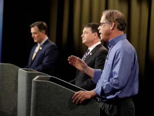 Senate candidate Mike Braun, right, speaks during the