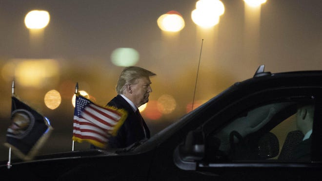 President Donald Trump arrives at Palm Beach International Airport in West Palm Beach, Friday, Feb. 14, 2020.
