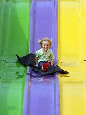Arthur Matej, Jr., 4, of La Quinta makes his way down a tall slide during the 8th annual Sacred Heart School & Parish Fall Carnival on Sunday, October 26, 2014 in Palm Desert, Calif.
