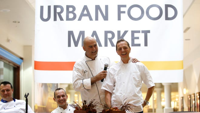 Four chefs from Italy, Rudi Sacchet, from left, Alessandro Di Maggio, Mirko Di Giacomantonio, and Ferruccio Cosenza are introduced at the Centre of Tallahassee on Tuesday where there are plans to launch an urban market with foods prepared by the four chefs.