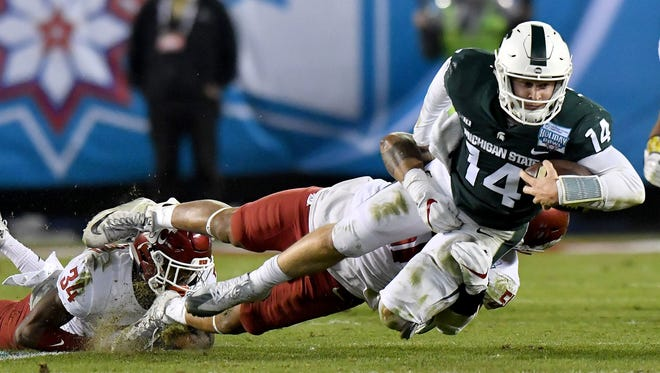 Brian Lewerke threw for 213 yards, rushed for 73 and had three touchdowns in Thursday's 42-17 Holiday Bowl win over Washington State.