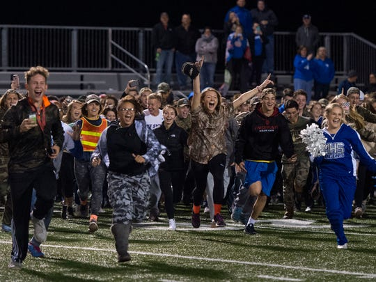 Memorial students storm the field after the Memorial Tigers defeated Gibson Southern 26-17 to claim the Class 3A Sectional 32 championship title at Gibson Southern High School in Fort Branch, Ind., on Friday, Nov. 3, 2017.