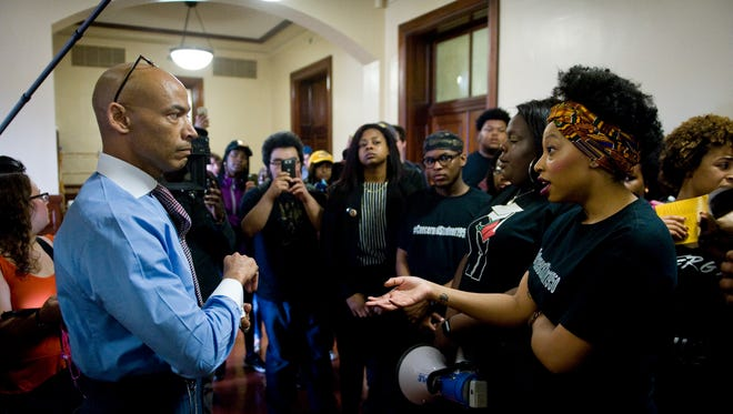 """Concerned Student 1950 members confront Mizzou's Interim Vice Chancellor for Inclusion, Diversity and Equity Chuck Henson during a """"Still Concerned"""" march on March 7."""