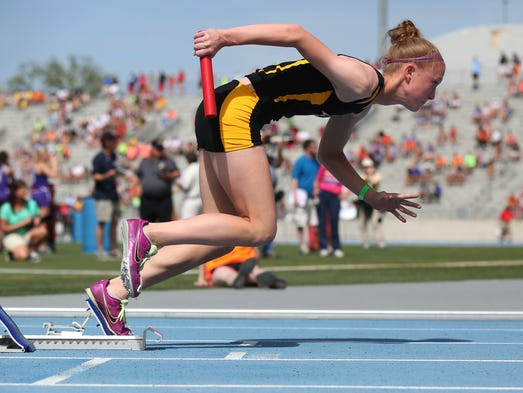 Southeast Polk's Brianna Hersom explodes from the blocks to start her team's 4x400-meter relay in Iowa Class 4A on Saturday, May 24, 2014, during the Iowa state high school track and field meet at Drake Stadium in Des Moines.
