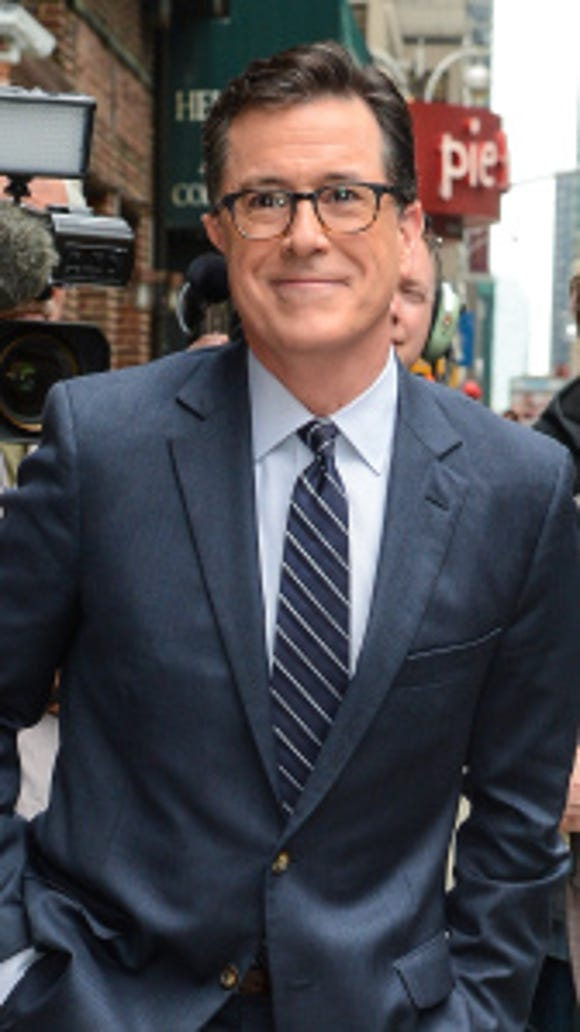 """Television personality Stephen Colbert enters the """"Late Show With David Letterman"""" taping at the Ed Sullivan Theater on April 22, 2014 in New York City. (Ray Tamarra/WireImage)"""