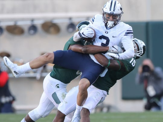 Michigan State Spartans Tyson Smith tackles BYU Cougars