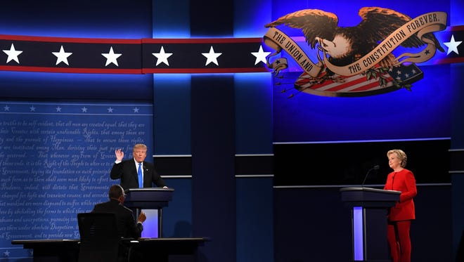 Republican presidential candidate Donald Trump and Democratic presidential candidate Hillary Clinton debate during the first presidential debate at Hofstra University.