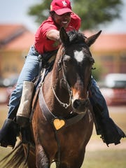 Reginashea Thomas from Fort Riley pets her horse after