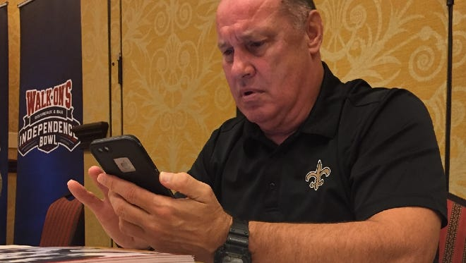 Former Ole Miss, Saints quarterback John Fourcade checks his messages during an SBSC event last week in Bossier City.