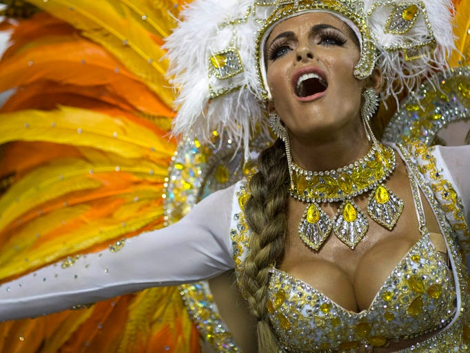 A performer from the Vila Isabel samba school parades during carnival celebrations at the Sambadrome in Rio de Janeiro, Brazil, Tuesday, March 4, 2014. Brazil's Carnival is maintaining its frenetic pace, with hundreds of roving parties taking over Rio de Janeiro's streets and famed samba school parades heading into their final night. (AP Photo/Felipe Dana)