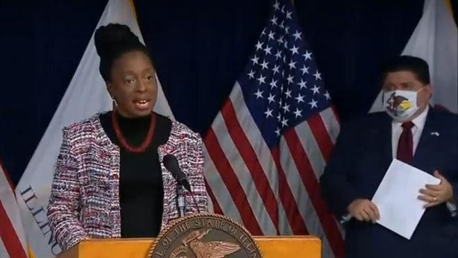 Dr. Ngozi Ezike, Illinois Department of Public Health director, and Gov. JB Pritzker address the news media at a COVID-19 briefing in Chicago Tuesday.