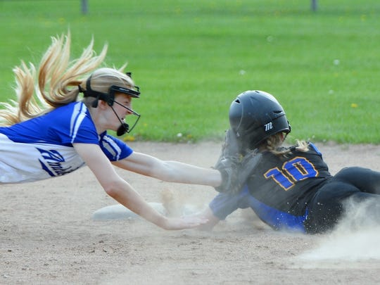 Oconto's Hannah Wusterbarth attempts to beat the tag from Amherst's shortstop, Grace Moe, in the bottom of the 6th inning.