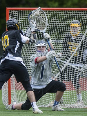 Harwood Union's Connor Cameron, left, shoots and scores against Burlington's Sullivan Weston in Burlington on Friday.