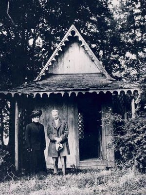 Mr. and Mrs. Thruston Ballard (Sunshine Harris Ballard) pose in front of a small study once used by Episcopal Bishop Benjamin Bosworth Smith, when it was still in back of his former home on Tremont Drive in today's Upper Highlands.