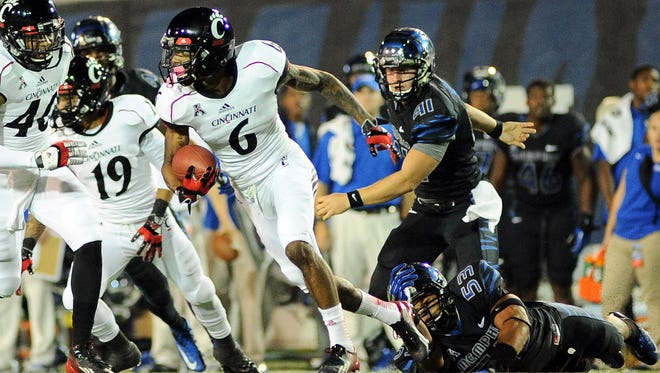 Cincinnati Bearcats wide receiver Anthony McClung carries the ball against Memphis Tigers during the second quarter at Liberty Bowl Memorial.
