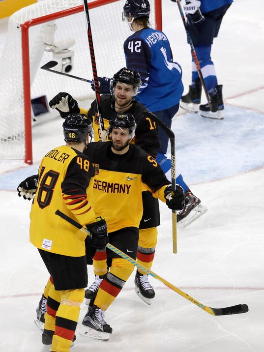 Frank Hordler (48), of Germany, celebrates a goal against Finland with his teammates during the third period of the preliminary round of the men's hockey game at the 2018 Winter Olympics in Gangneung, South Korea, Thursday, Feb. 15, 2018. (AP Photo/Matt Slocum)