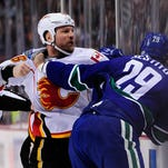 One of several fights that broke out in the initial seconds of the Calgary-Vancouver game, January 18, 2014