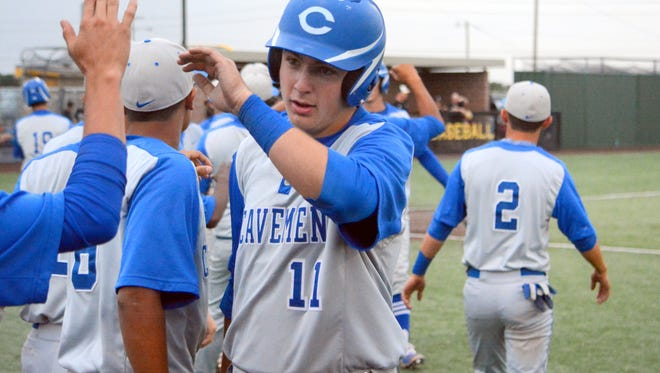 Carlsbad's Will Fiala celebrates scoring a run in game two Friday at Hobbs.