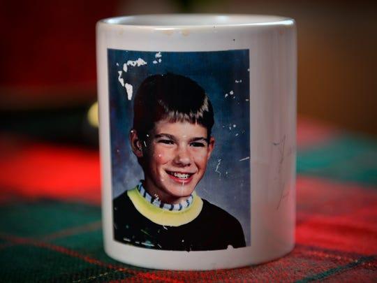 A weathered mug bearing Jacob Wetterling's photo sits