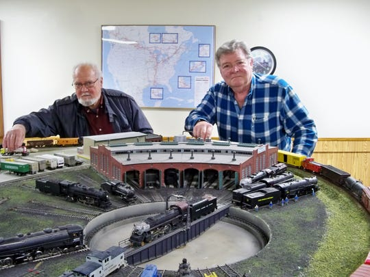 Clipper City Model Railroad Club will host its Thanksgiving Train Show Nov. 24-26 at Manitowoc County Expo Grounds. Pictured working on the show's layout are Paul Kopidlansky (left) and Frank Burke.
