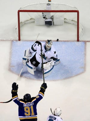 Sharks goalie Martin Jones (31) gives up a goal by the Blues' Jori Lehtera as St. Louis' Vladimir Tarasenko (91) celebrates during the second period in Game 1 of the Western Conference final on Sunday night.