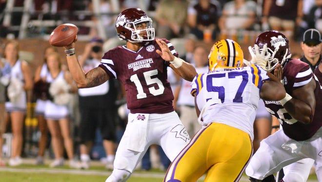Mississippi State Bulldogs quarterback Dak Prescott (15) drops back to pass  during the LSU game.