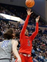 Maryland Terrapins guard Kaila Charles (5) shoots against Connecticut Huskies guard Molly Bent (10) in the second half at XL Center on Nov. 19 in Hartford, Conn.