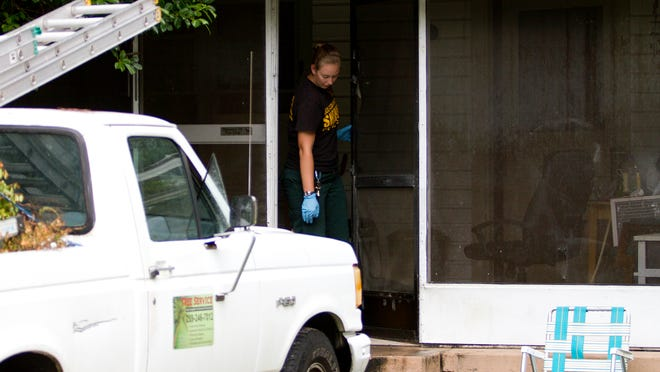 Lee County Sheriff's Office crime scene technician Lindsay Thomson investigates a home at 238 Capitol St. in North Fort Myers.