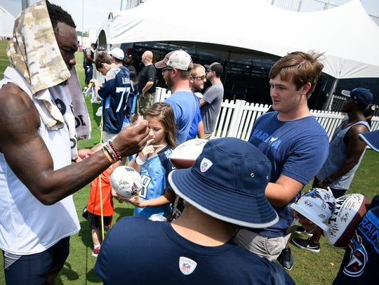 Titans wide receiver Corey Davis signs autographs for