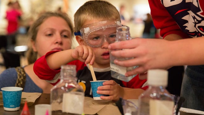 Oliver Kilbride, 3, learns about what solutions go together in order to make Slime while he was at Chemistry Day at the Evansville Museum on Sunday afternoon.