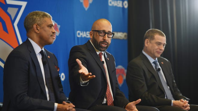 Knicks new head coach David Fizdale (C) talks to reporters as Steve Mills (L), President and Scott Perry (R), General Manager listen during a press conference at Madison Square Garden in New York  on 05/08/18.