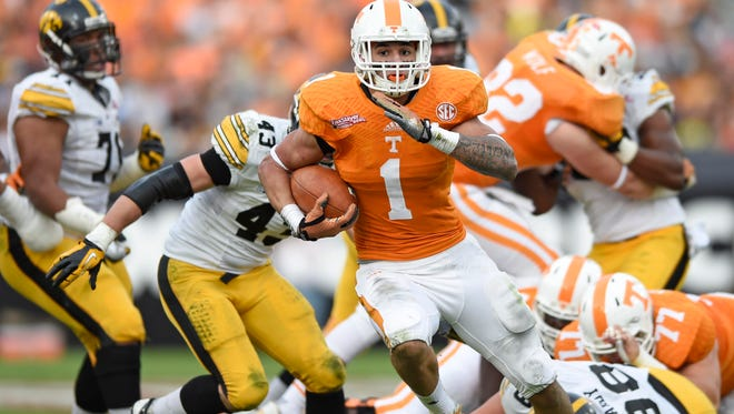 Tennessee running back Jalen Hurd (1) runs for his second touchdown during the first half against Iowa in the Taxslayer Bowl at EverBank Field on Jan. 2, 2015, in Jacksonville, Fla.